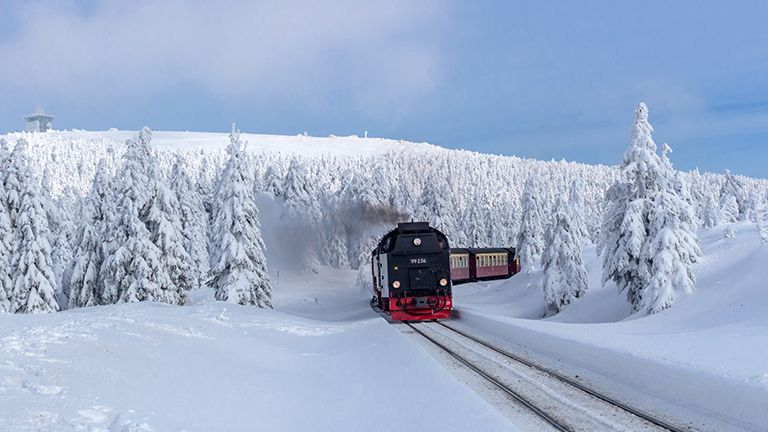 on the way in the winter landscape through the beautiful harz